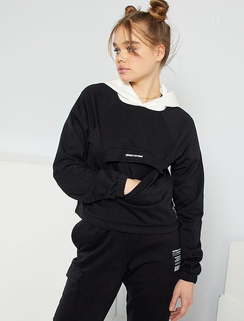 Cropped sweater met capuchon                             zwart